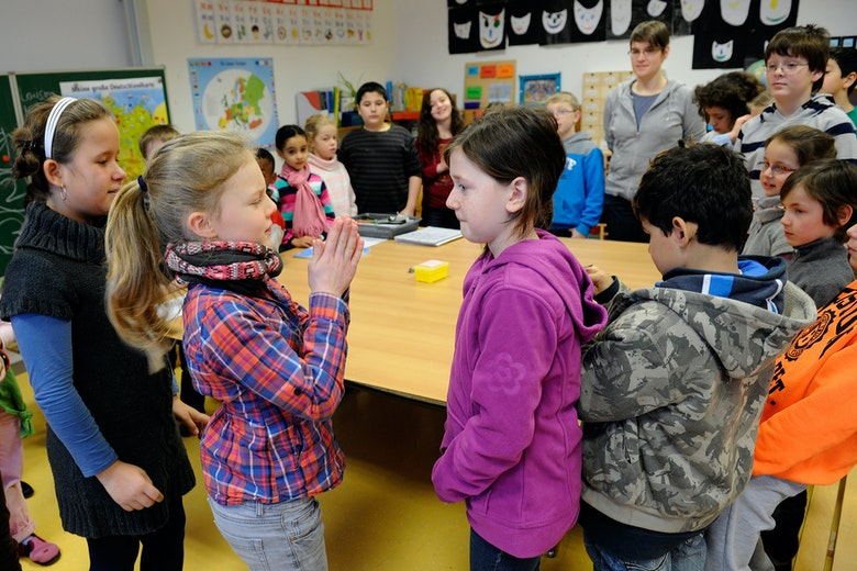 Students learn and play together in an inclusive classroom in Germany.