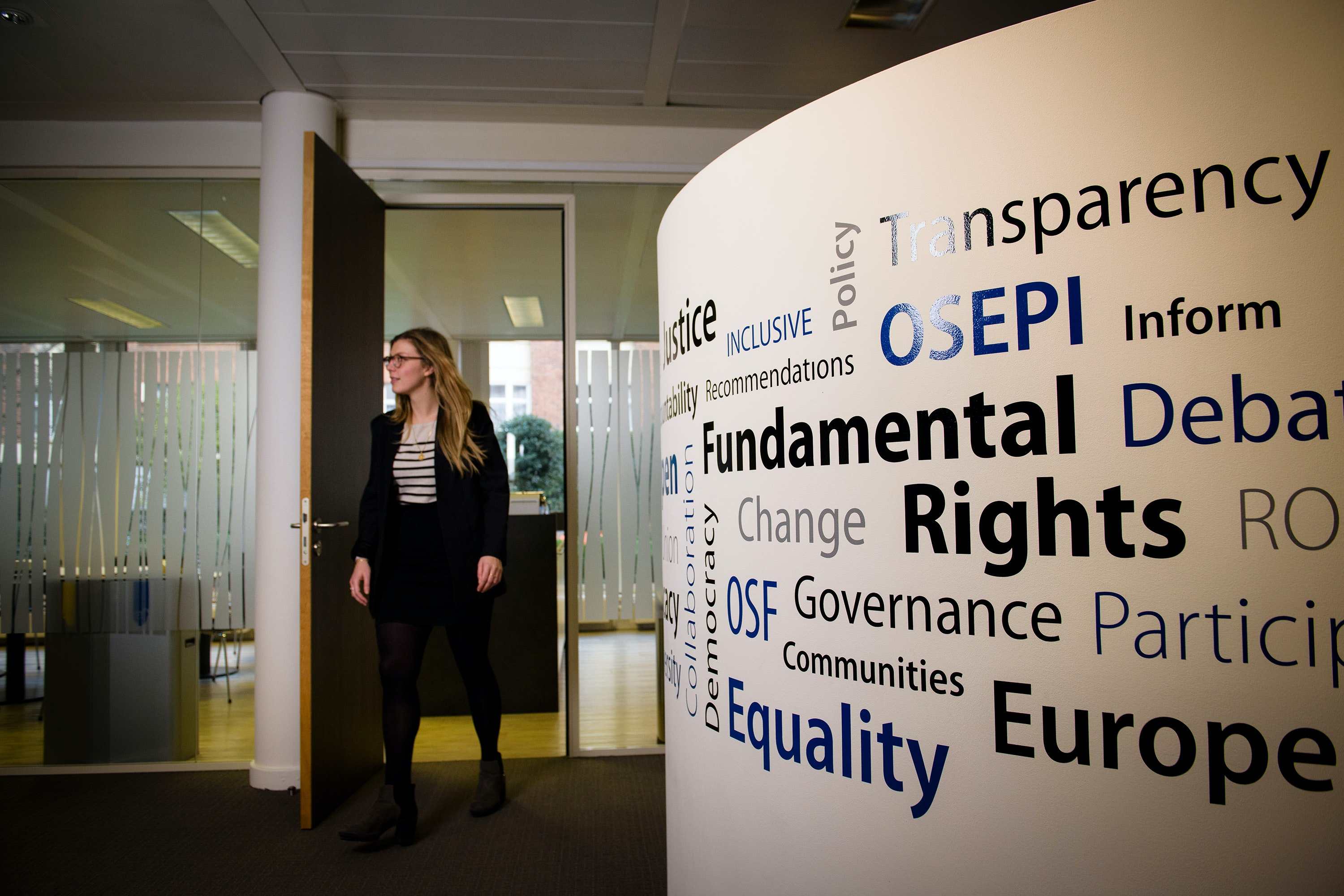 A person walks through an office in Brussels, Belgium.