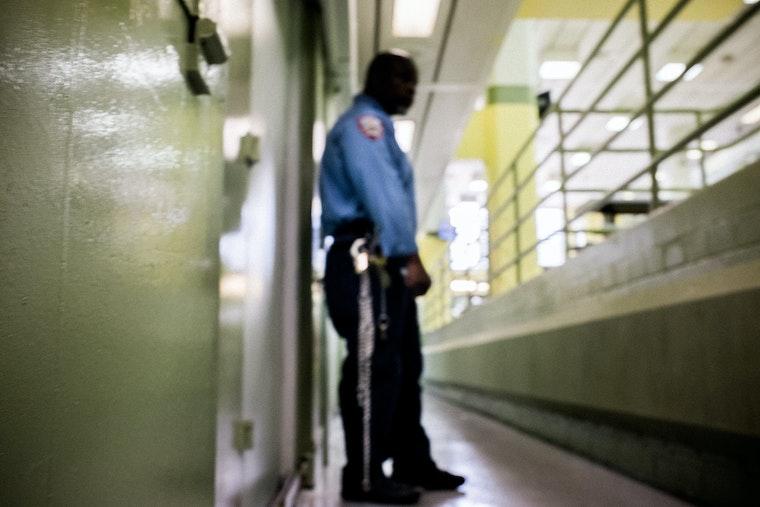 A prison guard outside jail cells