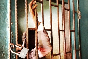 A suspect in a holding cell