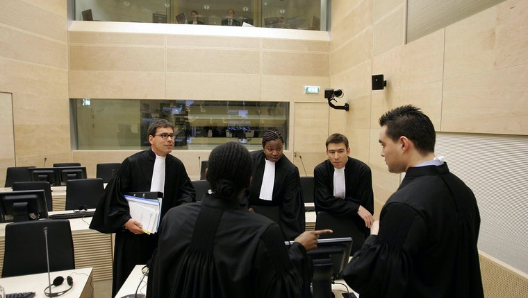 Judges talking in a court room