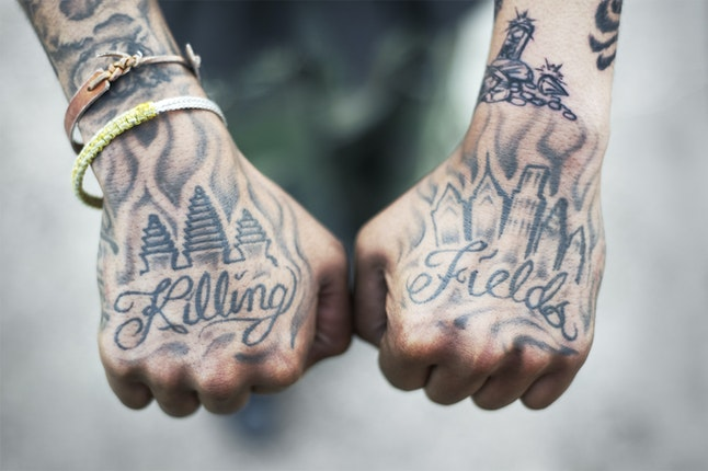 Man shows tattooed hands