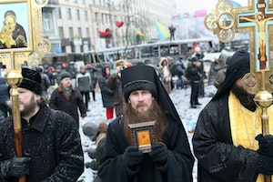 Priests holding religious objects standing